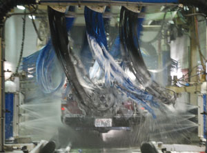 Photo of carwash scrubbers washing a truck.
